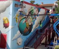 Il murales di Zed1 sulla palestra della Pescetti
